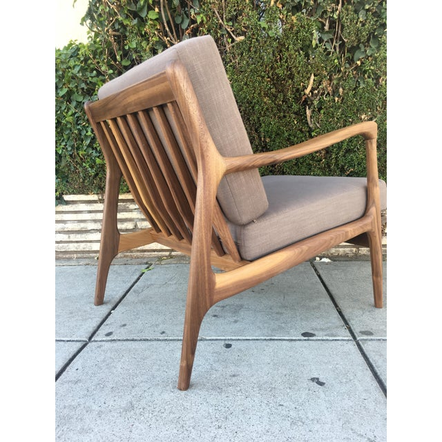 Costume Lounge chair in a gorgeous grain solid walnut wood frame makes this piece structurally strong, while the fresh...