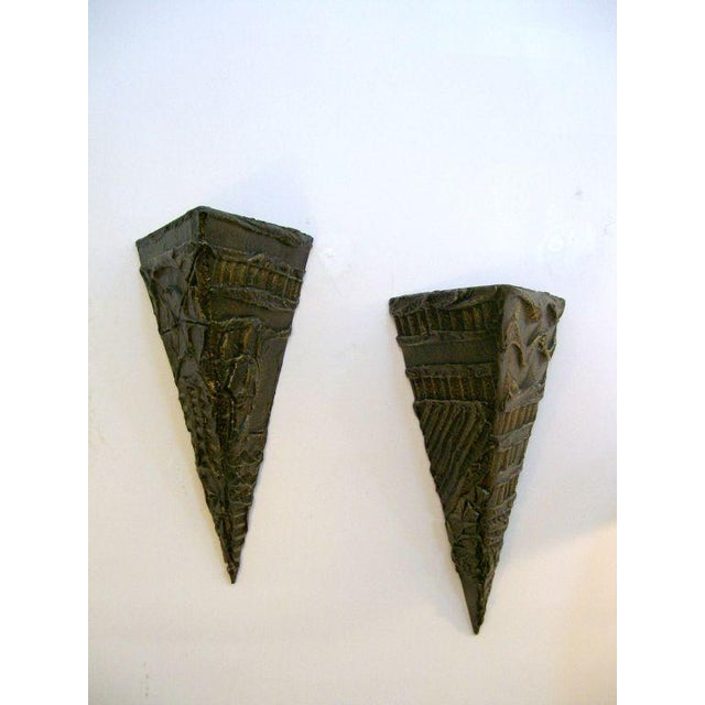 Wonderful Brutal triangular wall shelves with well worked design in sculpted bronze.