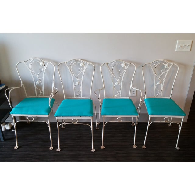 Unique John Salterini iron chairs from his Magnolia Group. Dated 1928-1953. Set includes four chairs: two side chairs and...