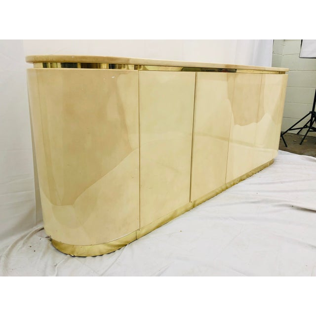 Stunning Vintage Mid Century Modern Bone Finish Credenza Sideboard Cabinet with Brass Wrapped Plinth. Original finish...