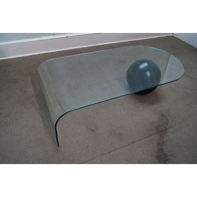 Mid-Century Modern Curved Waterfall Glass Coffee Table with Sphere AGE/COUNTRY OF ORIGIN: Approx 30 years, America...