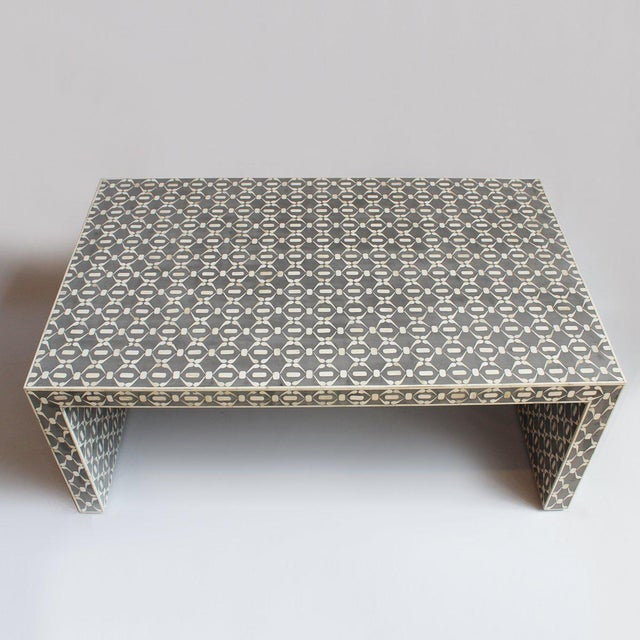 Modern design inlay coffee table with cement grey ground color. It features a hand carved intricate design all over. It's...