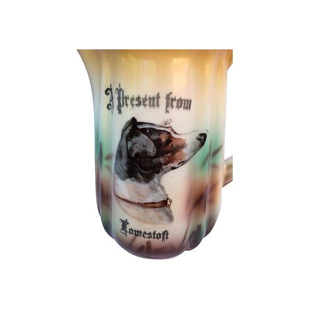 "Bisque porcelain pitcher ""A present from Lowestoft"" featuring a portrait of a dog. Stamped ""18"" on the bottom."