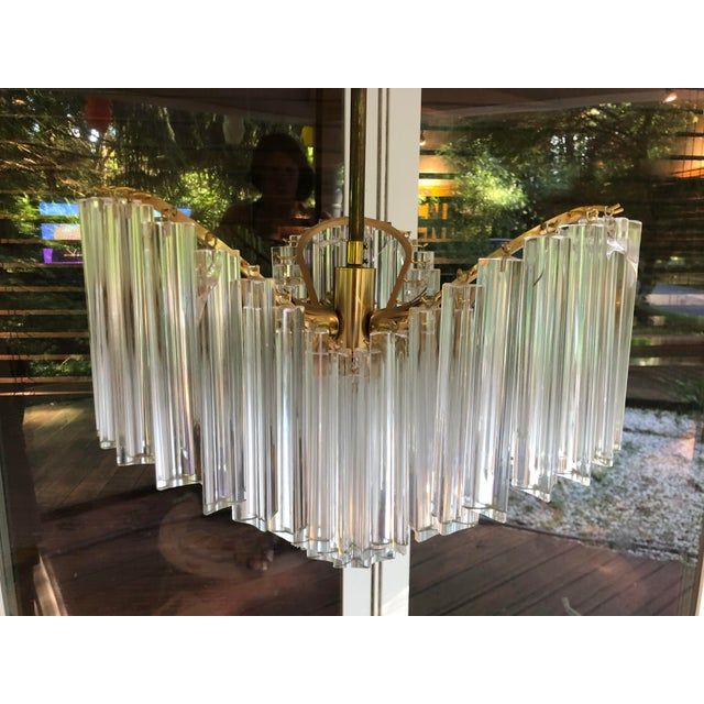 """This is a Camer Murano glass chandelier. With original box from Italy. Includes 58 prisms that are 8"""" in length. 1 3/4""""..."""