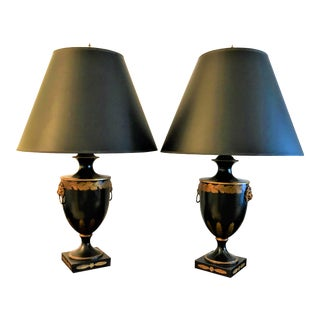 Vintage Black Urn Style Lamps With Gold Painted Leaves and Metal Lion's Head Detail - a Pair For Sale