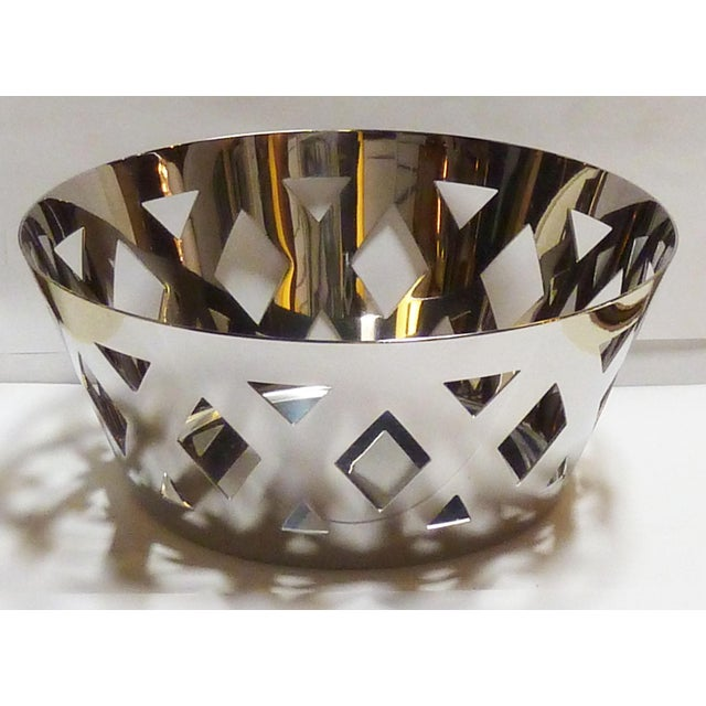 Stainless steel fruit bowl by Alessi, Italy. Great geometric shapes and modern design.