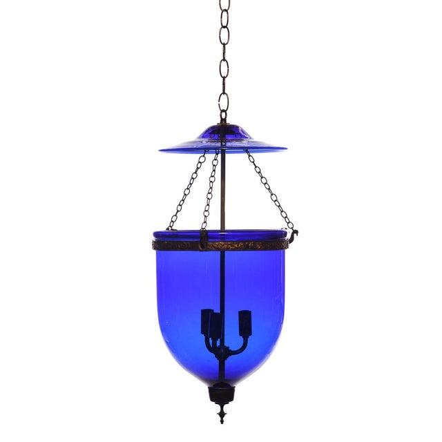3-light Indigo Blue Glass Bell Jar Pendant fixture. A beautiful hand blown Indigo blue Anglo-Indian glass jar pendant,...