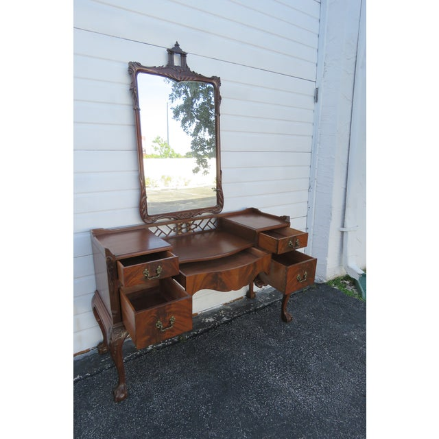 This gorgeous 1940's Chippendale Vanity Table and Mirror has beautiful carving, ball and claw feet, and is in good...