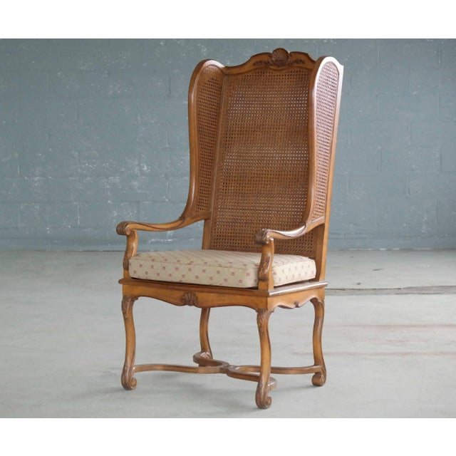 Super stylish 1920s American Hollywood Regency tall wingback chair in rare double cane. The chair shows appropriate age...