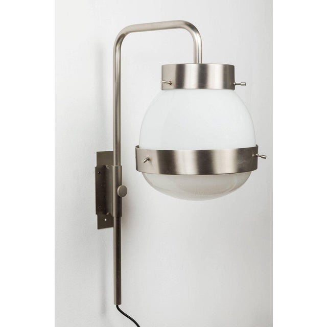 Pair of 1960s Sergio Mazza 'Delta' wall lights for Artemide. Executed in nickeled brass, glossy opaline glass and pressed...