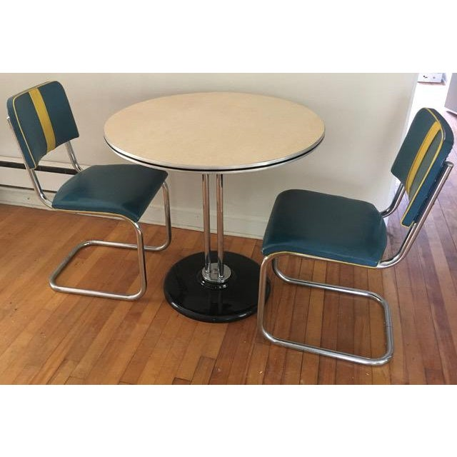 A rare three-piece dinette set by RoyalChrome Furniture from the 1930s. Round formica table has no blemishes to the...