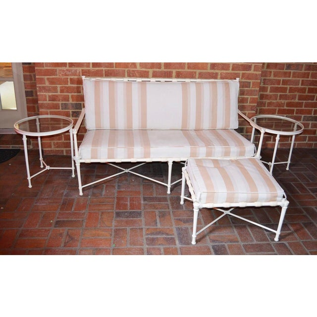 A Vintage Brown Jordan outdoor patio Sofa/Sette, Ottoman and two (2) Accent tables. This vintage set features cream tone...