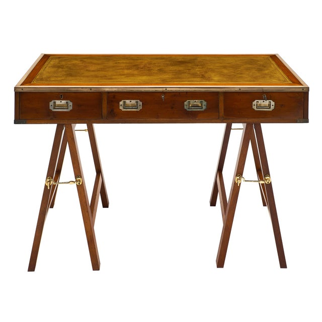 A fun, versatile Campaign style vintage writing desk with three dovetailed drawers and inserted solid brass handles. Brass...