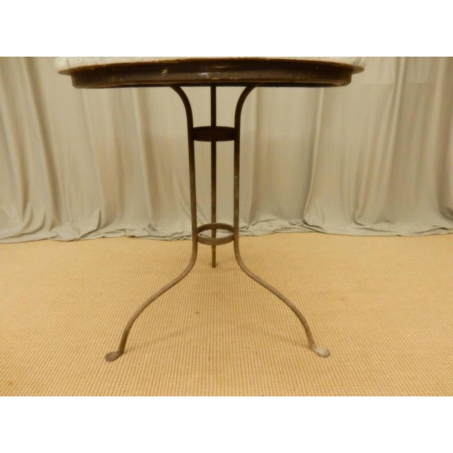 Softly painted faux marble Provincial Italian iron base table. Circa 1890.