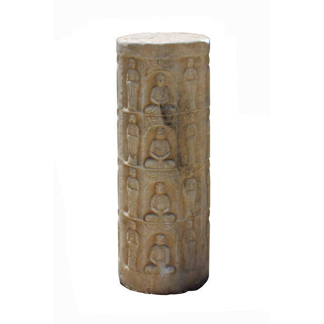 This is a standing Chinese Buddhas pole carved from brownish white color stone. There are carving on each side, a tower of...
