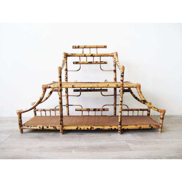 Pagoda style bamboo wall mounted etagere. Charming pagoda two-tiered shape with faux-tortoiseshell finish, can be either...