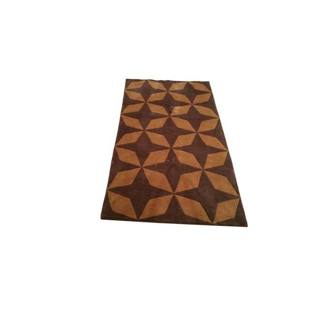 Infuse a touch of beauty to high-traffic areas of your home with this durable, golden brown, Modern Nepalese rug. The rug...