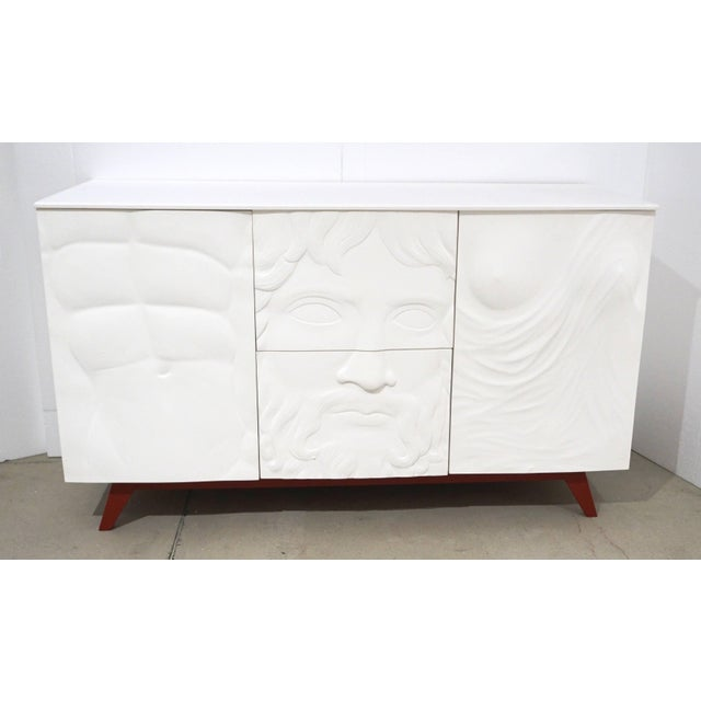 Exclusive made in Italy contemporary credenza or dresser with a Renaissance flair, the three front panels in bas-relief...