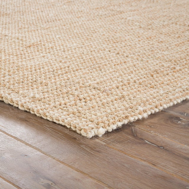 This natural jute area rug offers a neutral foundation to transitional homes. With a chunky weave, this casually elegant...