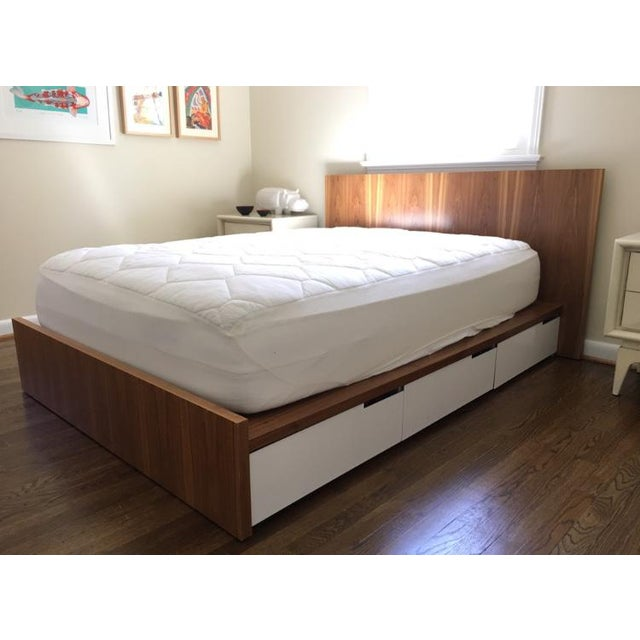 Walnut bed by Blu Dot, excellent condition.** This is an extremely well made made modern bed. The walnut has beautiful...