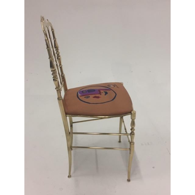 Very glamorous brass spindle motif side or desk chair with crest at the top and new Picasso inspired seat fabric. Chiavari...