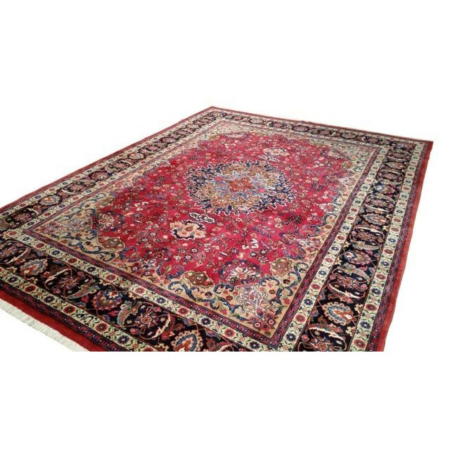 Infuse a touch of beauty to high-traffic areas of your home with this durable Persian Sarouk rug in colors of red, white,...
