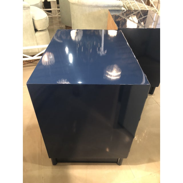 Lovely vintage pair of NEWLY lacquered professionally navy nightstands. Mirrored Chinese Chippendale doors open to reveal...