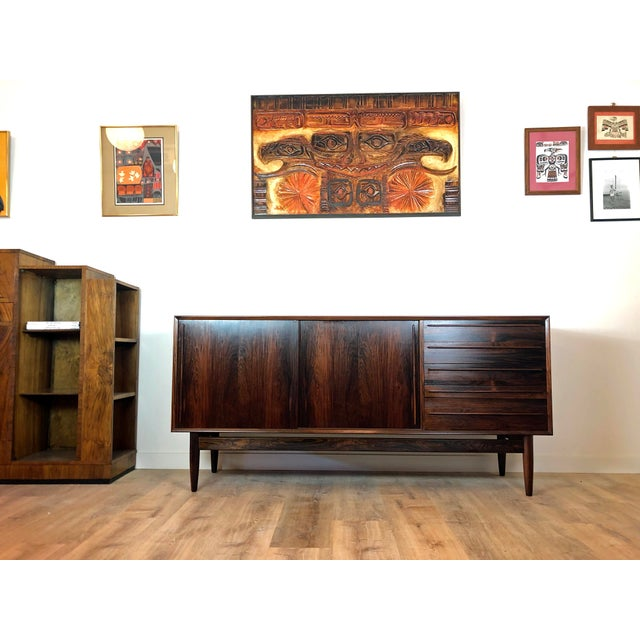 Danish mid-century modern rosewood credenza in absolutely excellent vintage condition. Beautiful wood grain throughout and...