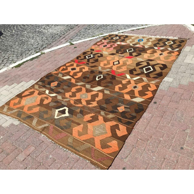 This beautiful, vintage, handwoven kilim is approximately 70 years old. It is handmade of very fine quality wool and...