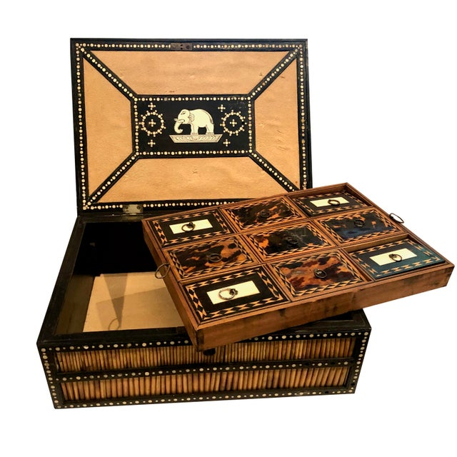 19th century Anglo Indian porcupine quill decorated work box on ebony with bone inlay. The interior has the complete set...