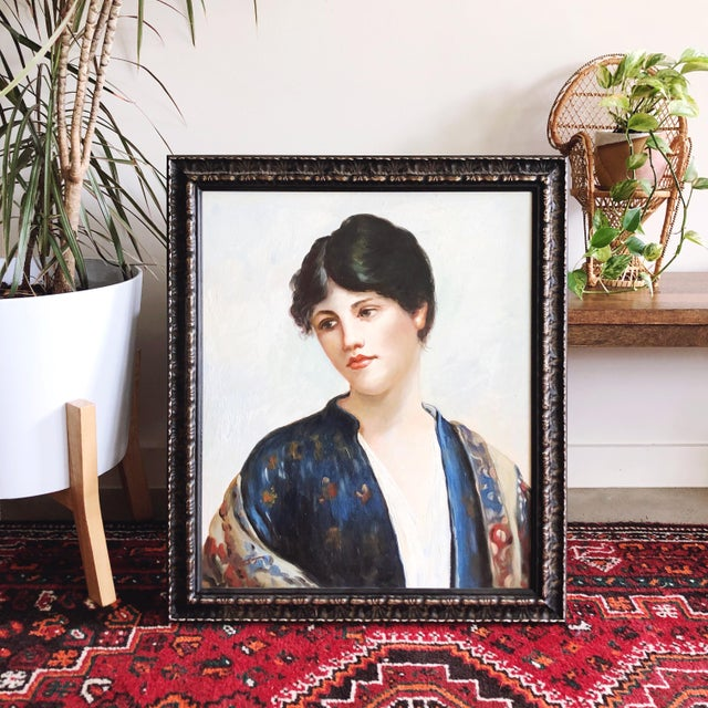 Stunning oil painting of a woman in bold jewel tones and exquisite detail. Framed in a black and gold wooden frame. The...