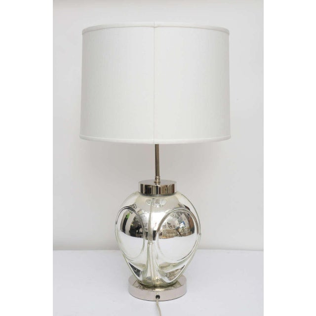 This handsome, polished chrome and mercury-glass table lamp dates from the 1970s with there optic-bubble detail. Shade not...