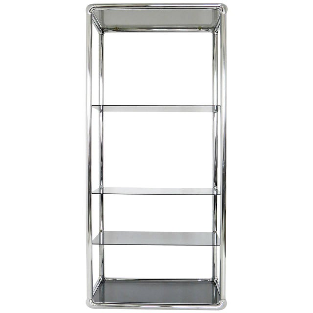 A modern, 1970-1979, chrome and smoked glass etagere. It could be used in your office or in your home to display your...