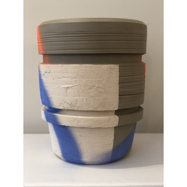 Ceramic planter with orange and blue spray paint design. Handmade in Italy.