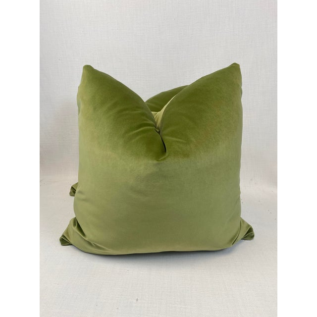 "Custom pair of 22"" pillows covered in a leaf green velvet. These pillows have tapered corners to prevent dog ears,..."