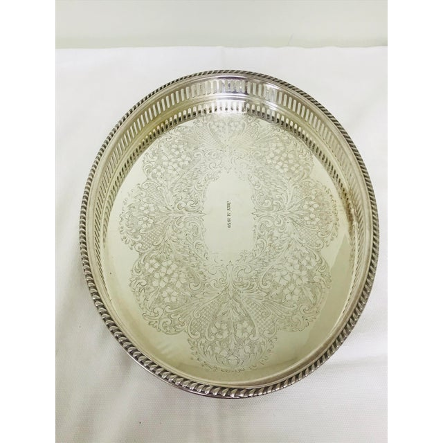 Vintage silverplate ball footed gallery tray by W & S Blackinton. The date July 31, 1959 is engraved top center.