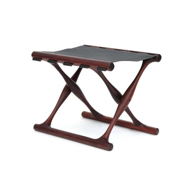 Rare Poul Hundevad rosewood and leather folding stool circa late 1950s. This example is solid rosewood and has been newly...