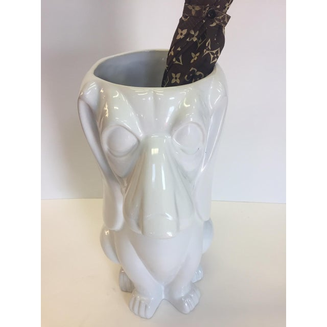 A whimsical droopy eared basset hound dog in white ceramic makes a wonderful umbrella stand. Could be a great centerpiece....