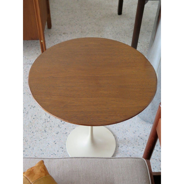 A Classic Eero Saarinen for Knoll occasional table with walnut top. Excellent original condition, base has a cream color,...