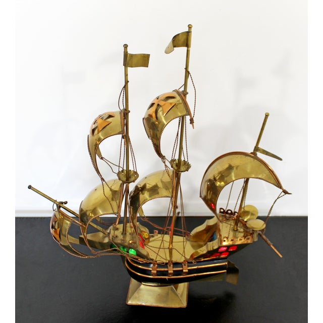 For your consideration is a unique, light up, brass & copper table sculpture of a sailboat, circa the 1970s. In very good...