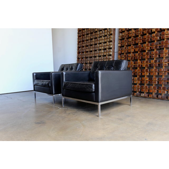 Pair of Florence Knoll black leather lounge chairs. Manufactured by Knoll, circa 1970 Beautiful patina to the original...
