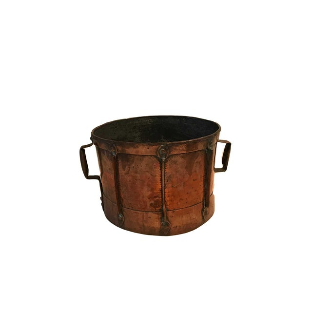 18th century French Louis XV firewood basket holder. The log holder is made of polished copper with 2 copper handles on...