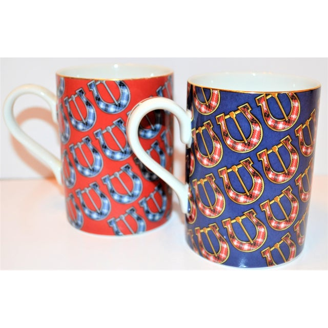 This is a set of two Gucci Mugs in the belt buckle china pattern. These are from the 1990's Gucci Home Decor collection....