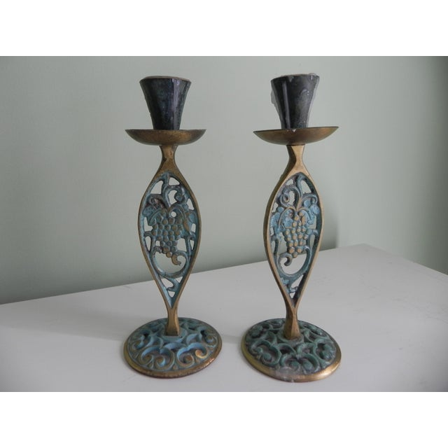 Attractive brass candle holders with verdigris featuring grapes on the vine. Made in Israel. 1970s