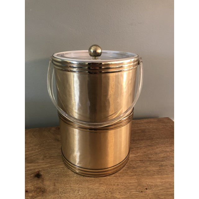 Perfect for the holidays Gold shiny vintage ice bucket Lucite handle and lid Stamped on bottom
