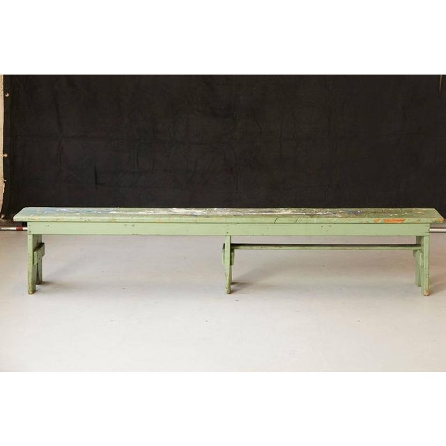 Very unique and colorful primitive green painted pine bench with lots of color splashes from an artist's atelier. The long...