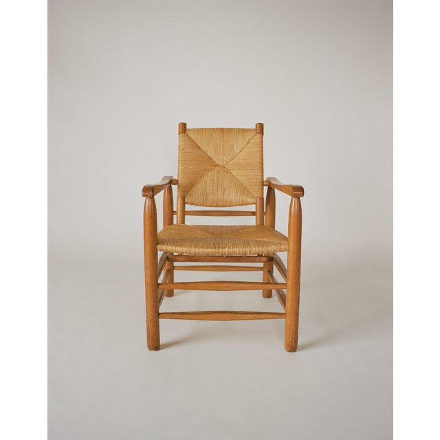 An adaptation by Charlotte Perriand of one of her earlier, more rustic armchair designs from 1935. The revisit to earlier...