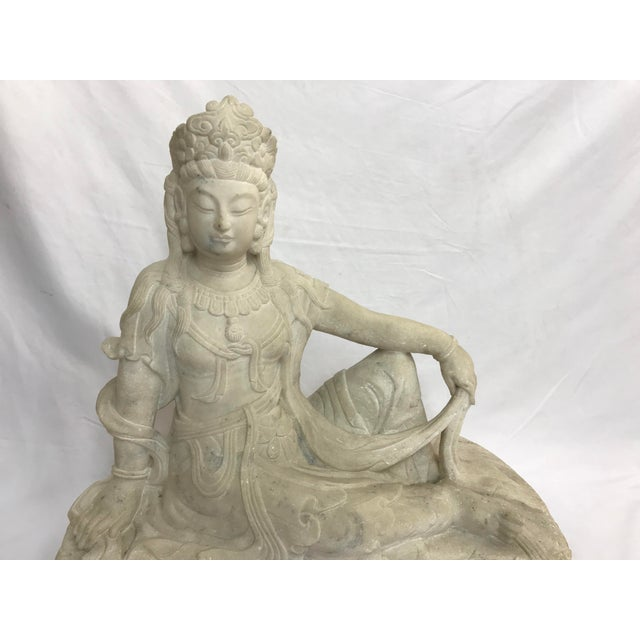 Quan Yin figure, reclining, carved from light gray marble with a few faint darker gray streaks. It measures, 21 inches...