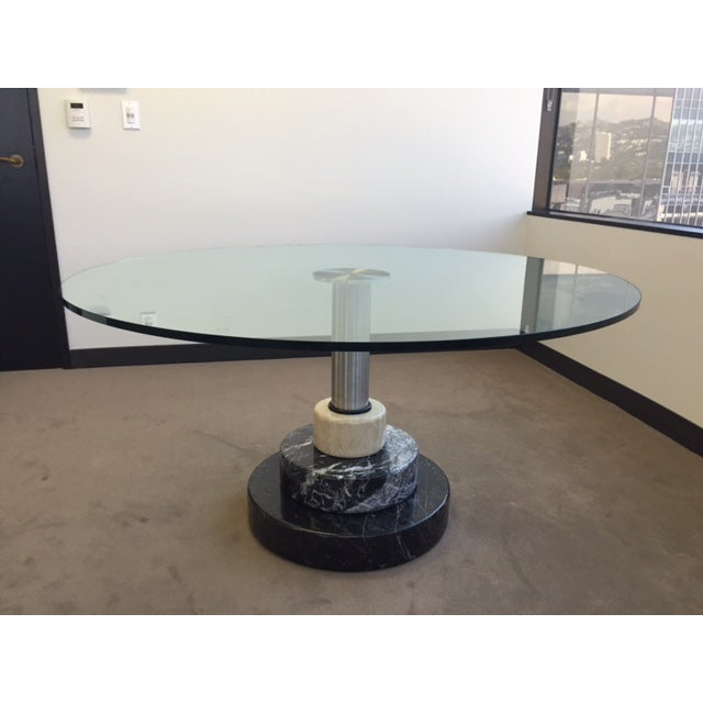 A beautiful marble and glass table designed by architects and designers Lodovico Acerbis and Giotto Stoppino. This...