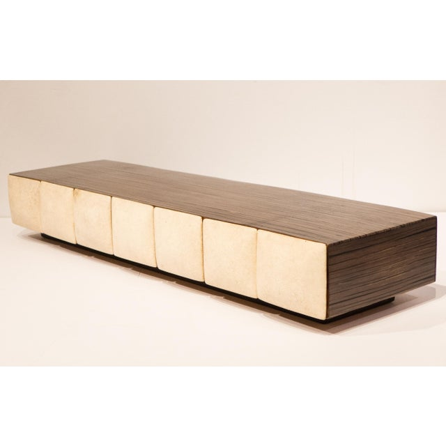 Horizontal jewelry box of spliced bamboo on plinth base, featuring seven wooden drawers with convex shagreen fronts. Made...